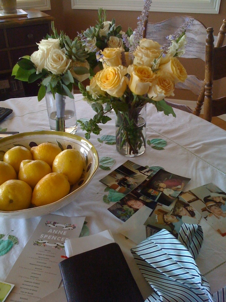 Still life photo with Roses, Norma's bible, wedding tie, family photos and the invitation for Anne and Spencer's Wedding