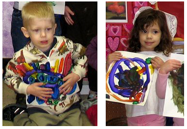 Preschoolers with heart art projects in hand