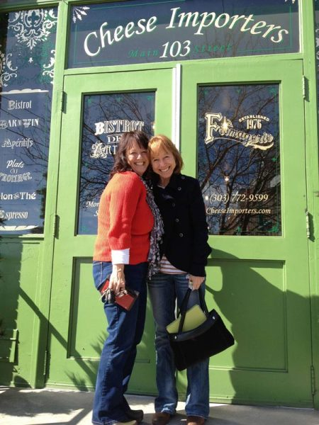 Karen's sisters pose at the front door of the Cheese Importers shop. Aren't they cute?