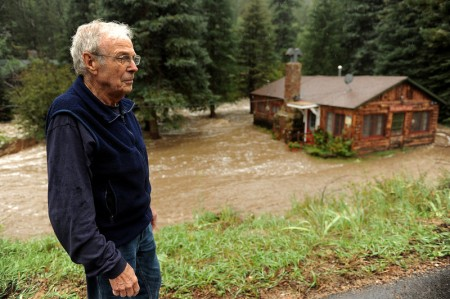 Longtime resident Gale Erlewine looks at his cabin that is completely surrounded by the South St. Vrain river near the roadside community of Riverside, about 12 miles west of Lyons, CO. along Highway 7 on September 12, 2013.   He has owned the cabin for over 20 years.  (Photo By Helen H. Richardson/ The Denver Post)